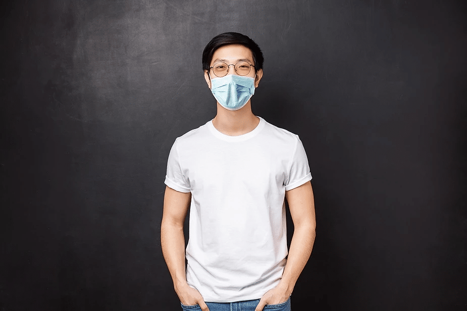 Male wearing glasses with face mask