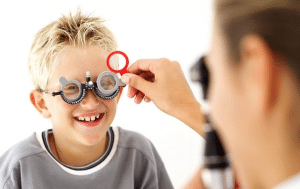 Young kid having eye test done